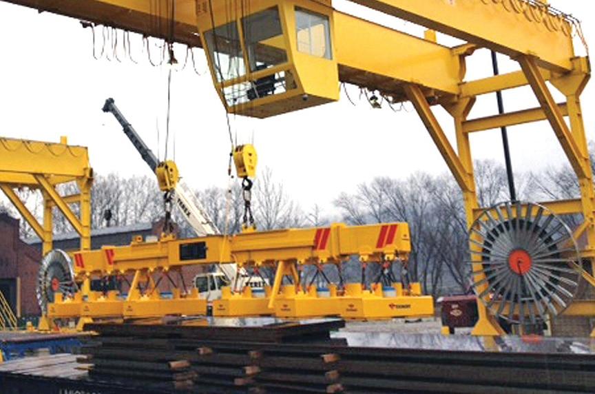 Crane Electrification: Conductor Bars vs. Cable Festoon vs. Cable Reel: Motor Drive Reel Outdoor Gantry