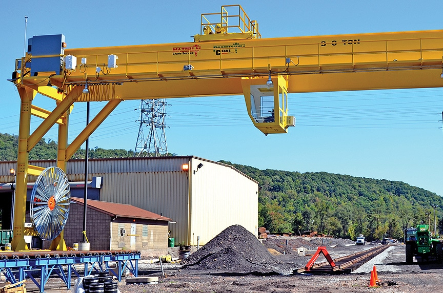Crane Electrification: Conductor Bars vs. Cable Festoon vs. Cable Reel: Motor Reel Outdoor Gantry