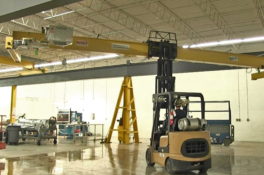 Installing an Overhead Crane in an Existing Building Structure: Raising Bridge Into Place