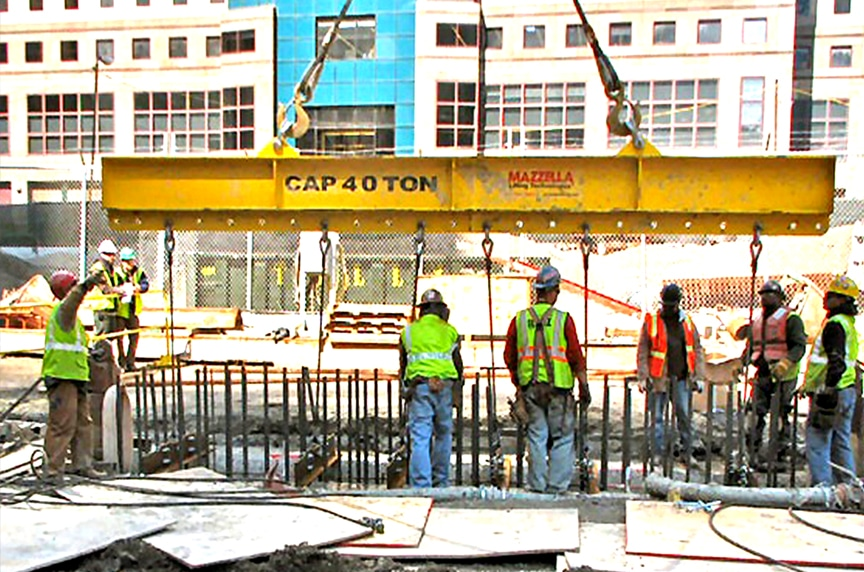 7 Things You Should Know Before Buying a Below-the-Hook Lifting Device: Lifting Beam On Construction Site