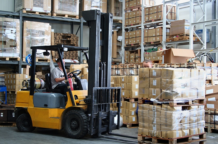 Forklifts vs. Overhead Cranes: Forklift in a Warehouse