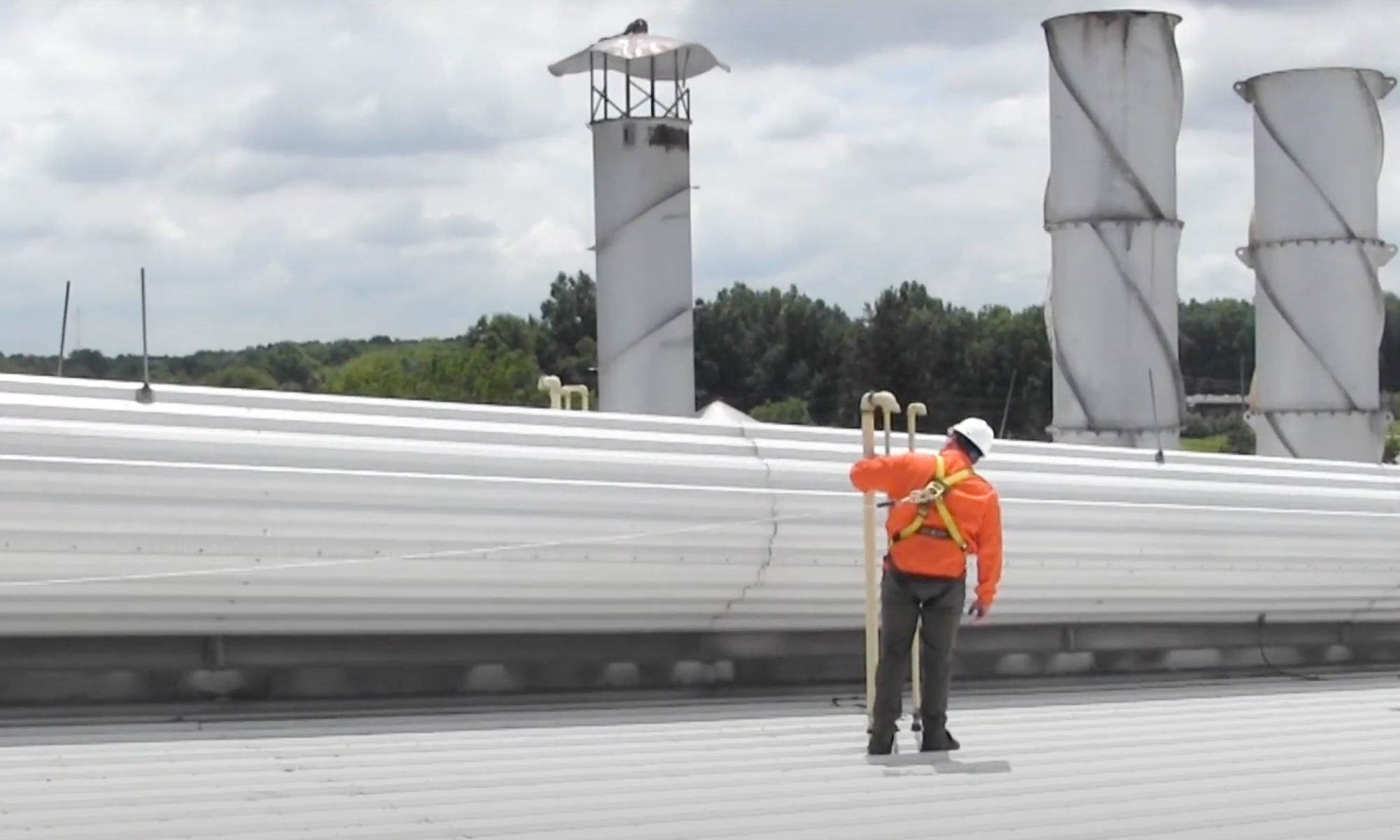 Workers at Height Protected by Horizontal Rooftop Lifeline System